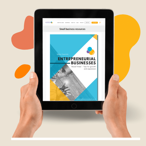 Hands holding iPad with cover of Wellers business guide