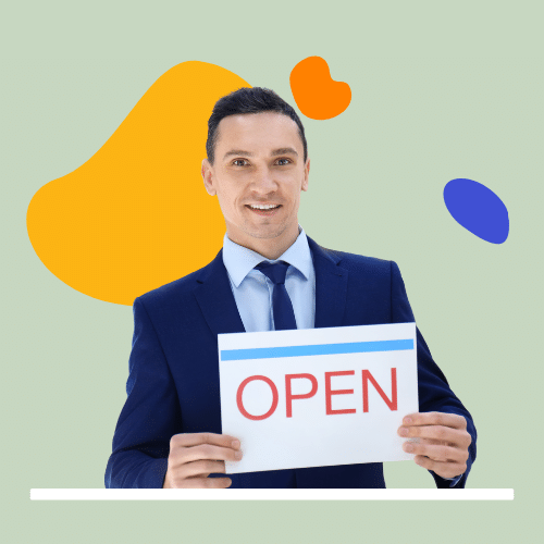 Person in suit holding open business sign