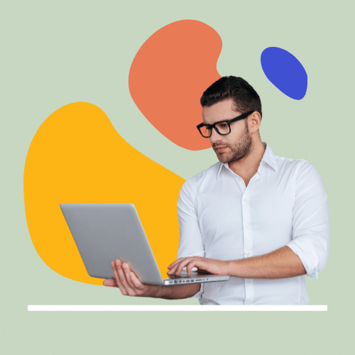 Person with glasses holding laptop