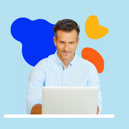 Person in blue shirt on computer