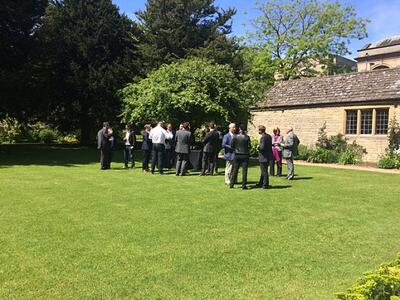 Guests enjoying drinks outside Rhodes House